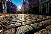 picture of paving stone  - Sunrise in a city street with paving stones - JPG