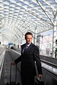 pic of trolley  - business man travel with bag and trolley on escalators - JPG
