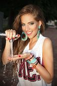 stock photo of woodstock  - Beautiful happy woman drinking water from tap - JPG