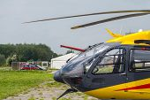picture of helicopters  - Fragment of the yellow modern new helicopter - JPG