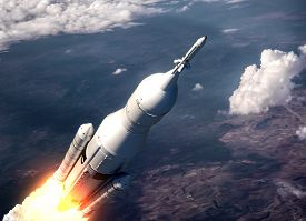 image of spaceman  - Space Launch System Flying Over The Clouds - JPG