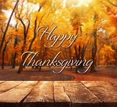Happy Thanksgiving Day. Beautiful nature background with wooden floor poster