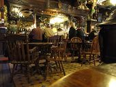 Patrons Sit At The Old Western Bar