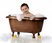 image of clawfoot  - A happy preschooler playing in a copper claw - JPG
