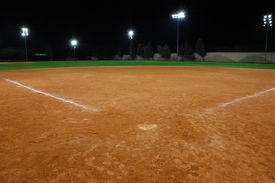 picture of softball  - a softball field at night after a game with the lights on - JPG
