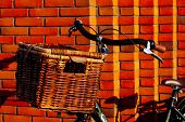 Large Vintage Wicker Brown Basket On A Bicycle. Old Dutch Bike With A Wooden Basket Place Against A  poster