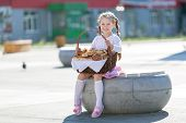 Little Girl With A Basket Of Bread. poster
