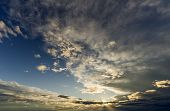 Fantastic Panorama View Of Bright White Gray Dark Wide Puffy Clouds Lit By Sun Spreading Against Dee poster
