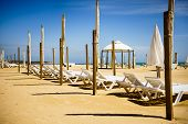 Algarve, Portugal, A Stunning Sea Ocean Landscape With Sunbeds And Umbrellas.  Cabo Da Roca, Portima poster