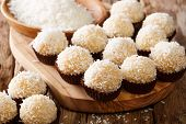 Delicious Brazilian Sweets Beijinhos De Coco With Condensed Milk And Coconut Close-up. Horizontal poster