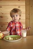 Child Eats His Breakfast. Healthy Food And Vitamin. Breakfast, Morning, Family. Small Boy Child Eat  poster
