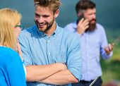Couple Having Fun While Busy Businessman Speak On Phone. Couple Flirting While Man Busy With Mobile  poster