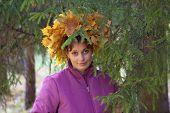 Girl In Wreath Of oranga and yellow Leaves