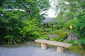 Outdoor Bench, Green Plants, Road And Pavilion In Japanese Zen Garden poster