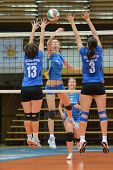 KAPOSVAR, HUNGARY - OCTOBER 2: Zsofia Harmath (C) in action at a Hungarian NB I. League volleyball g