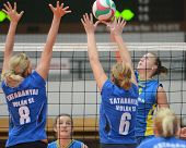 KAPOSVAR, HUNGARY - OCTOBER 2: Alexandra Csaszar (R) in action at a Hungarian NB I. League volleybal
