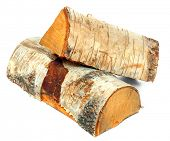 Stack of cut logs fire wood from Silver Birch tree (Betula pendula). Renewable resource of a energy.