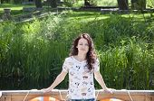 Pretty Hipster Woman Outdoor. Portrait Of The Beautiful Girl With Curly Brunette Hair. Spring Portra poster