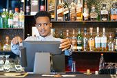 Registration Male Of Bartender Employee Of A New Order By A Cash Register. The Barman Pays The Order poster