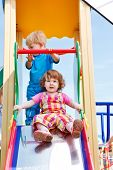 foto of chute  - Two toddlers on a chute - JPG