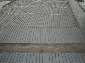Underfloor central heating and cooling construction phases