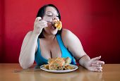 Overweight Woman With A Whole Chicken On Her Plate Stuffing Hers