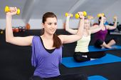 A Small Group Of Fit Young Woman Lifting Weights In A Health Club