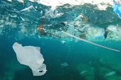 Plastic pollution in ocean. Plastic bags, straws and bottles pollute sea. Underwater trash photo poster