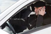 Man Talking On Phone While Driving