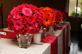 picture of flower vase  - Orange and pink Wedding flowers on the main table - JPG