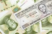 A Close Up Image Of A One Ethiopian Birr Bank Note On A Background Of Chinese One Yuan Bank Notes poster