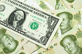 A Close Up Image Of A An American One Dollar Bank Note With Chinese One Yuan Bills In Macro poster
