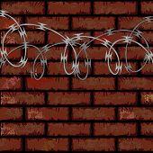 Brick Wall And Razor Wire