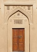 Ancient door with beautiful design on the top Riffa Fort