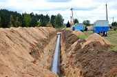 A Dug Trench In The Ground For The Installation And Installation Of Industrial Gas And Oil Pipes. Cr poster
