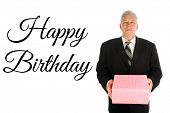 Happy Birthday. A handsome man in a suit holds a pink and white spotted gift box. Birthday gift in a poster