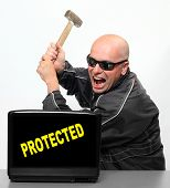 Frustrated hacker and protected laptop.