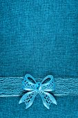 Elegant Shiny Blue Glitter Bow On Blue Colored Ribbon And On Blue Burlap. Vertical Greeting Card Bac poster