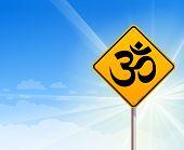 Om Yoga sign and blue sky