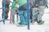 People Is Using A Ski Pass Card On The Lift Line At A Ski Resort In Winter Blizzard. poster