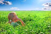 Relaxing Girl On Meadow Against The Blue Sky