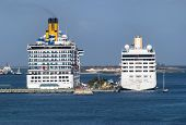 The Morning View Of Two Cruise Liners Moored In Nassau City Port (bahamas). poster