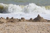 foto of azov  - sand castle on sea beach tide fon - JPG