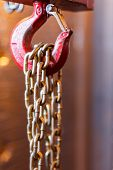 Metallic Chain Handle With Red Hook In Technical Room. Crane Cargo Hook. poster
