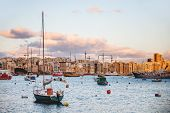 Sliema Seaside And Moored Sailing Ships. Yachts And Sunset Panorama View Of Sliema, Malta. poster