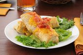 Plate Of Chimichangas With Cheese
