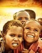 AFRICA, KENYA - NOV 8: Portrait of African children from the Masai Mara tribal village, near the Mas