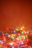 stock photo of christmas lights  - colorful twinkling christmas lights background with copyspace - JPG