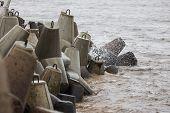 Baltic Sea Waves Hitting Stone Blocks Near Path To Ship Lighthouse. Path Located Near Ventpils Docks poster