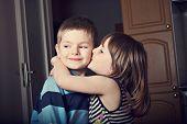 Adorable Little Girl Kissing A Boy